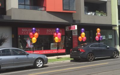 Outdoor Balloons -4 x 5 Balloon Clusters installed @ Solomons Flooring Essendon
